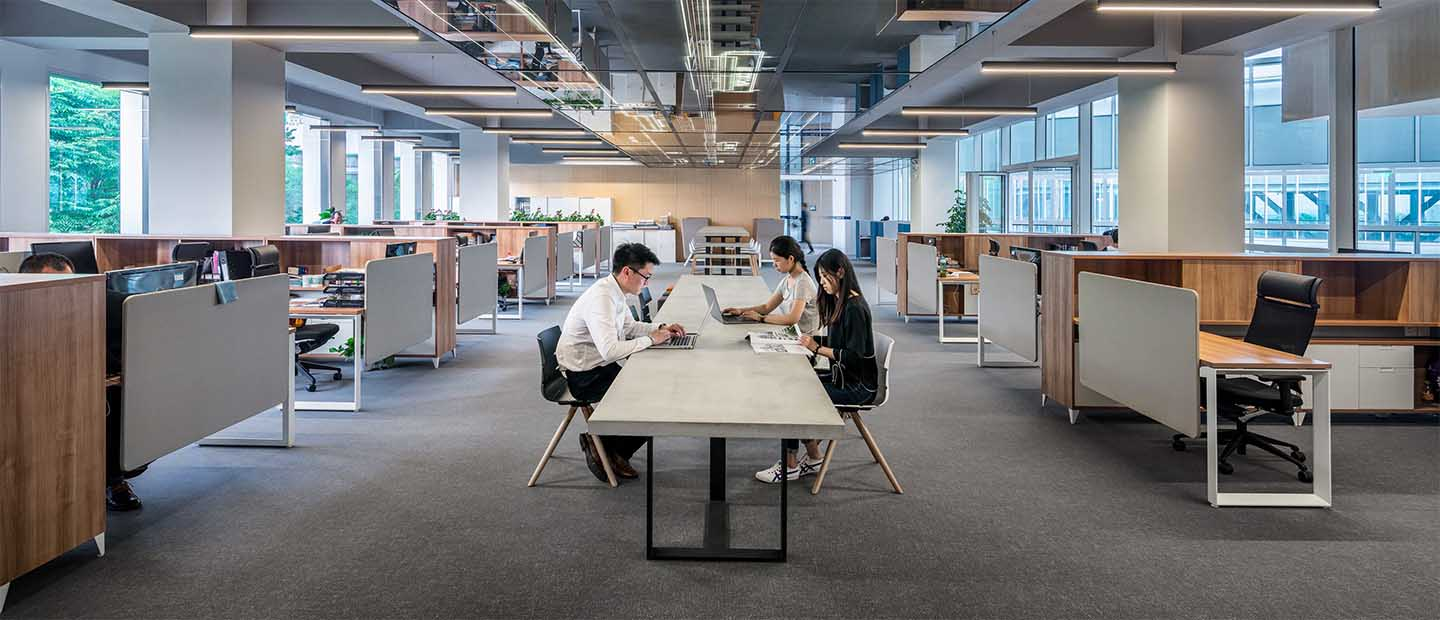 office-workers-sitting-by-table